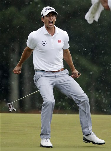 Adam Scott, of Australia, celebrates after a birdie putt on the 18th green during the fourth round of the Masters golf tournament Sunday, April 14, 2013.