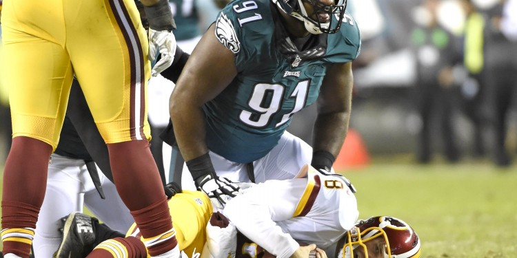 Dec 26, 2015; Philadelphia, PA, USA; Philadelphia Eagles defensive end Fletcher Cox (91) sacks Washington Redskins quarterback Kirk Cousins (8) during the second quarter at Lincoln Financial Field. Mandatory Credit: Eric Hartline-USA TODAY Sports