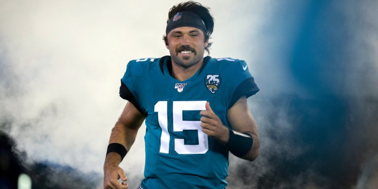 Jacksonville Jaguars quarterback Gardner Minshew (15) runs onto the field during the opening ceremonies of an NFL football game between the Jacksonville Jaguars and the Tennessee Titans, Thursday, Sept. 19, 2019, in Jacksonville, Fla. (AP Photo/Stephen B. Morton)